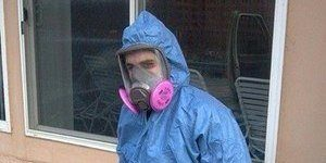 Mold Mitigation Tech On The Job In Proper Gear